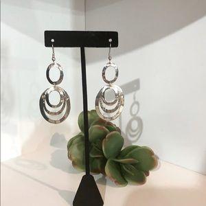 Loop Sterling Silver drop earrings.